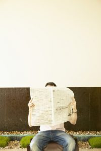 @Glowimages: Man with Newspaper