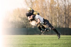 Two American football players in action. [fusion_builder_container hundred_percent=